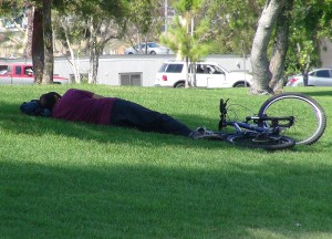 Woman stops to take a rest under the shady trees at Wilderness Park in Downey, Calif. Shade is one of the most popular reasons that community come to the parks. Photo by: Alicia Edquist